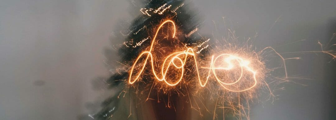 Light of a sparkler traces the word